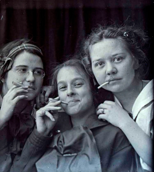 Three girls posing with cigarettes