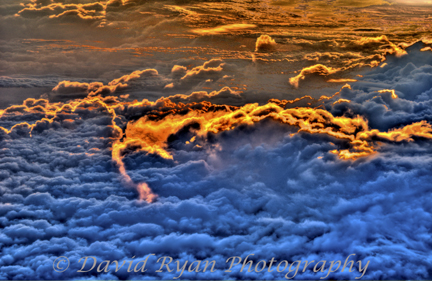 View of sunset and clouds from 32,000 feet