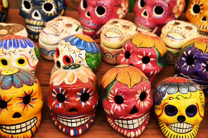 A display of colorful Mexican skulls